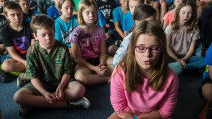 Students practicing breathing techniques.